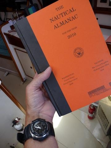 Quartz watch and Nautical Almanac