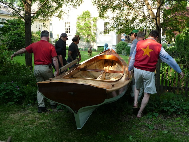 Carrying a skiff thru Phil's yard