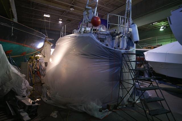 Tented sailboat prepped for sponge blast