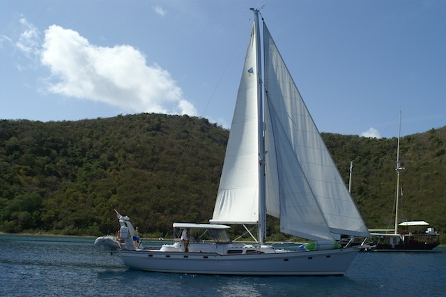 De-rigged ketch under sail