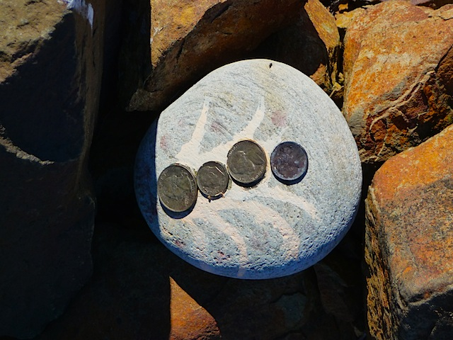 Rock and coins