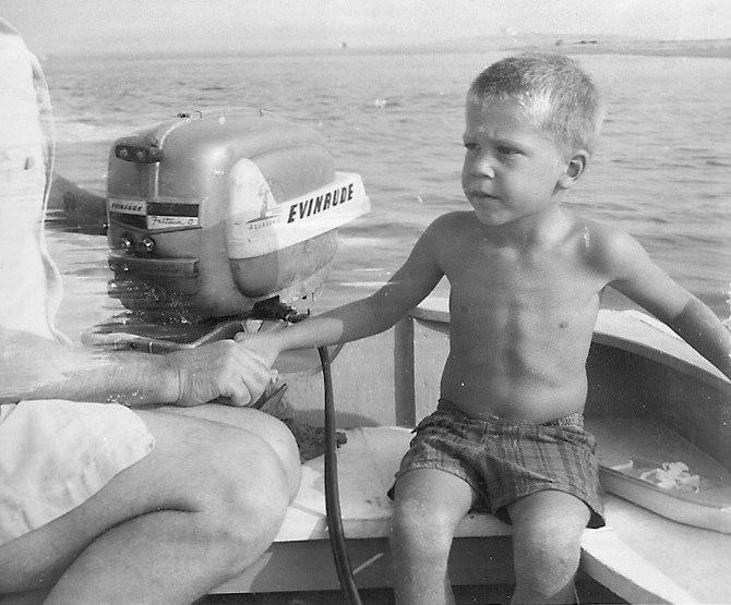 Boy in skiff