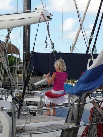 child swinging on boat