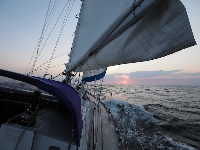 Lunacy sailing in sunset