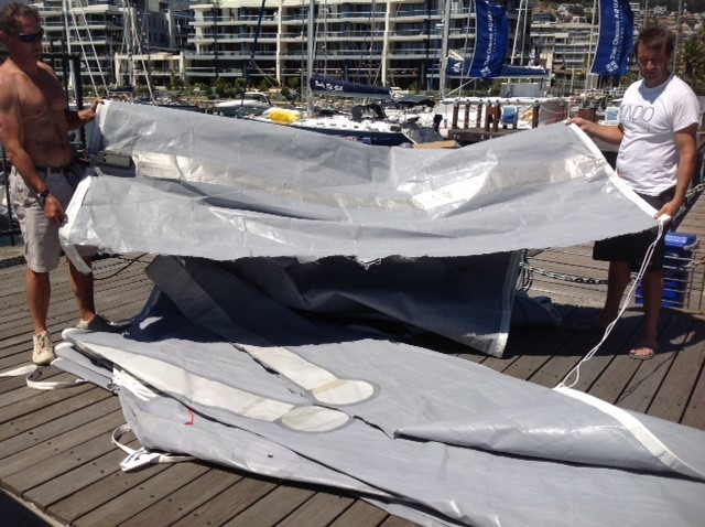 Torn mainsail on dock